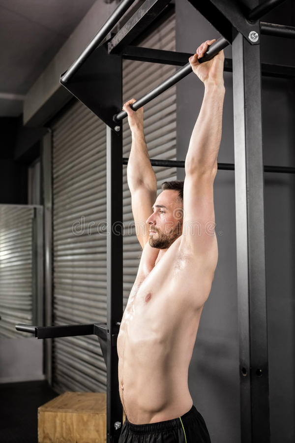 Muscular man doing pull up royalty free stock photo