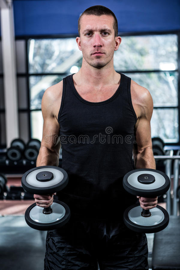 Mid Section Of Shirtless Muscular Man Exercising With