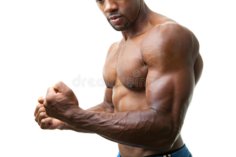 Muscular Man Flexing royalty free stock photography