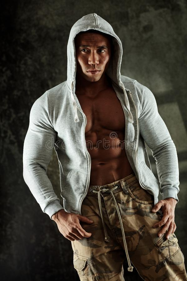 Muscular man in hoody royalty free stock images