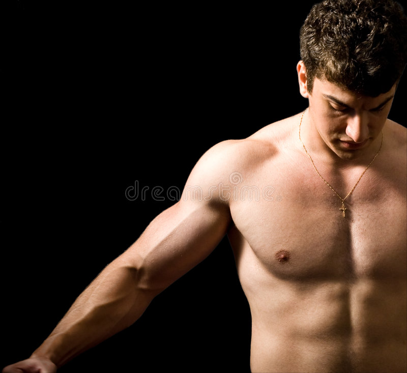 Muscular man isolated on black stock images