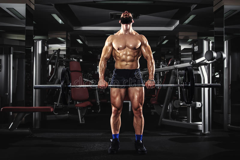 Muscular Man Lifting Barbells royalty free stock photos