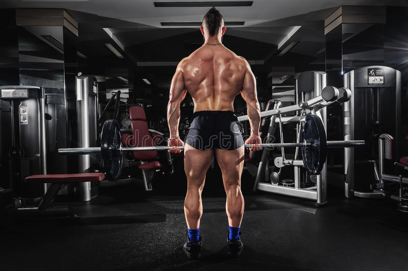 Muscular Man Lifting Some Heavy Barbells stock photography
