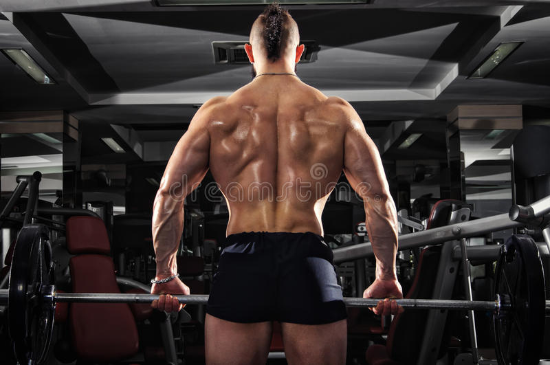 Muscular Man Lifting Some Heavy Barbells stock photos