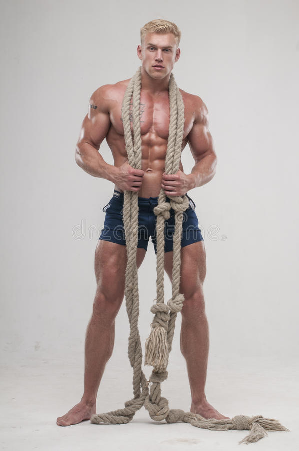 Download Muscular Man With Long Rope Stock Photo - Image: 34155768