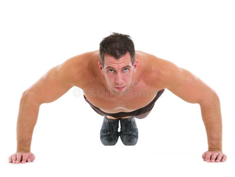 Muscular man making push up exercises stock photo