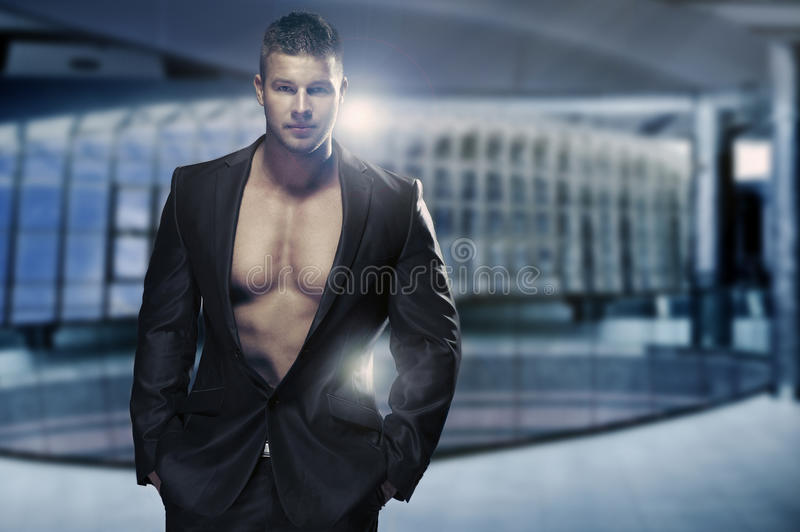 Muscular man in office royalty free stock image