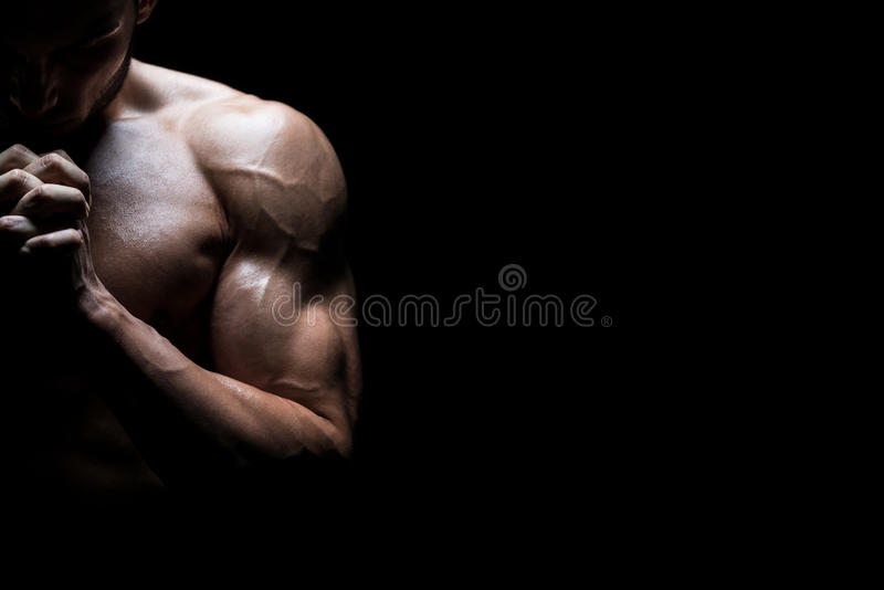 Muscular Man Praying. Spiritual Concentration Concept royalty free stock photography