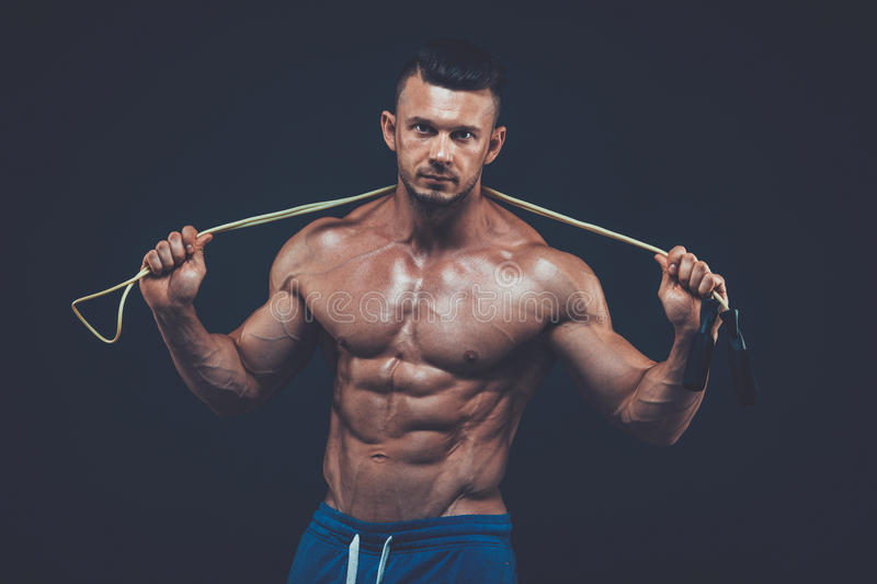 Muscular man skipping rope. active sport fitness stock image