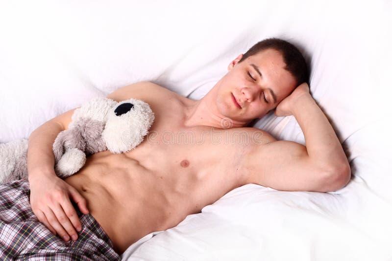 Muscular man sleeping stock image