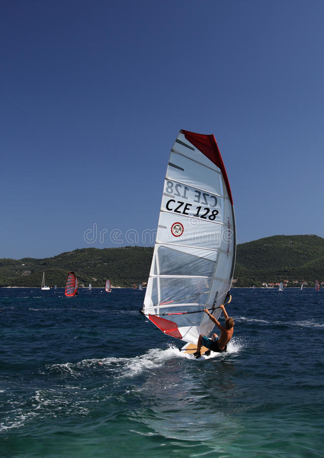 A muscular man windsurfing on a sea royalty free stock photography