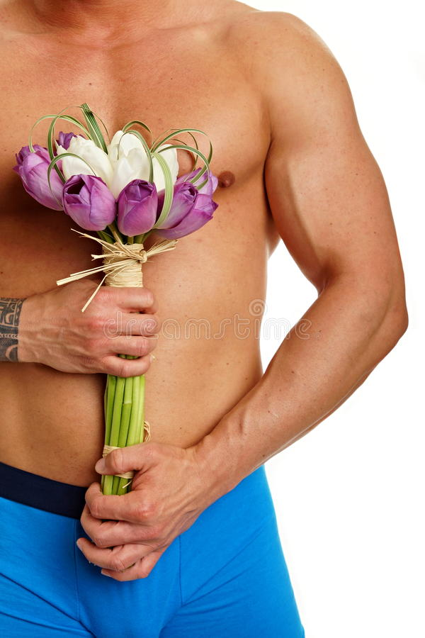 Free Muscular Man With Tulips Stock Photos - 46448643