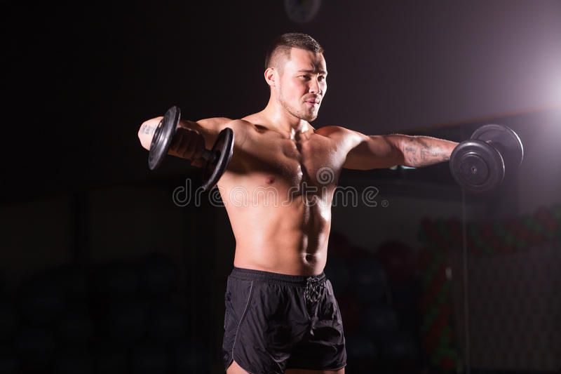 Muscular Man Working Out Gym Doing Stock Photo (Royalty