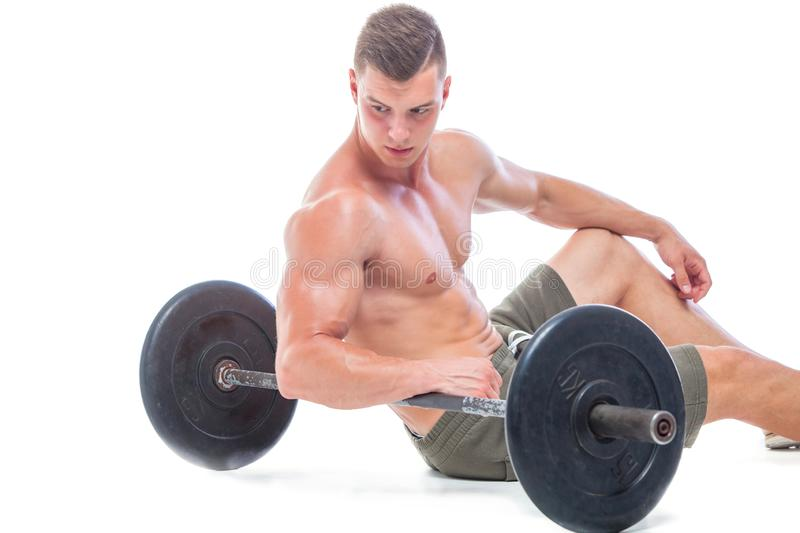 Muscular man working out in studio doing exercises with barbell at biceps, strong male naked torso abs. Isolated on. White background. Copy Space. Rest, Sits on stock photos
