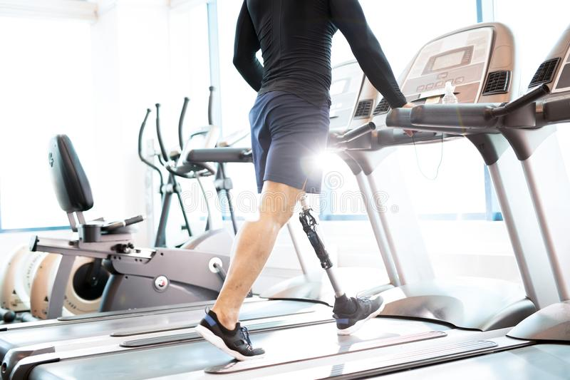 Muscular Man Working Out on Treadmill royalty free stock images
