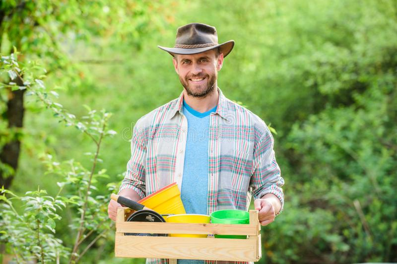 Muscular ranch man in cowboy hat. Eco farm worker. happy earth day. Eco living. farming and agriculture cultivation royalty free stock image