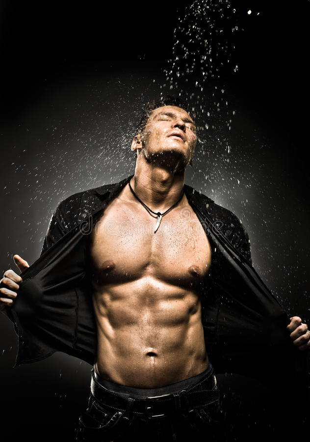 Muscular guy. The very muscular handsome guy under shower, naked torso stock photo