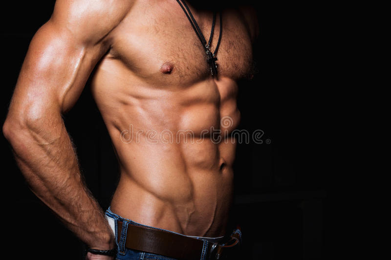 Muscular and torso of young man. With perfect abs stock image
