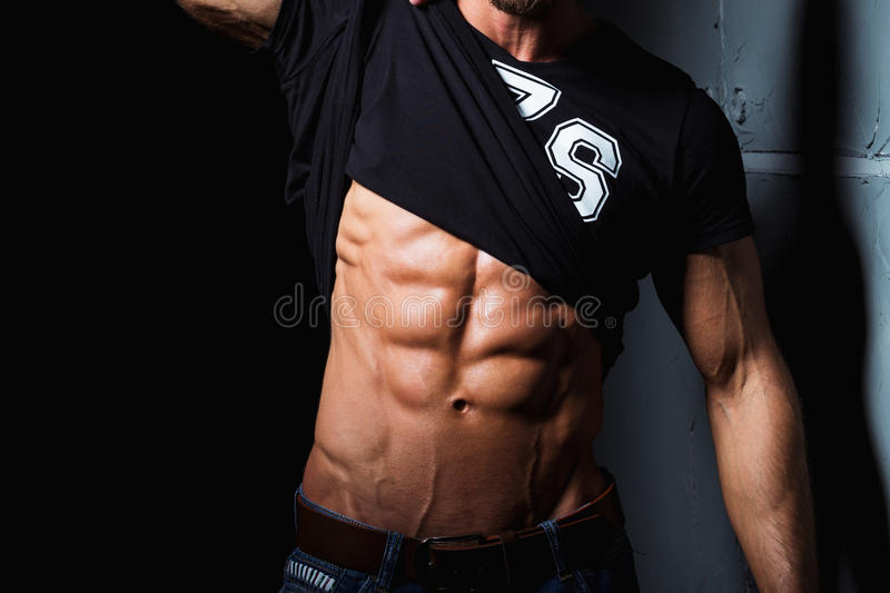 Muscular and torso of young man. With perfect abs royalty free stock images