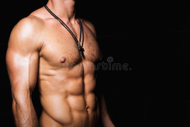Muscular and torso of young sporty man with. Muscular and torso of young sporty man bodybuilder with perfect abs and chest royalty free stock image