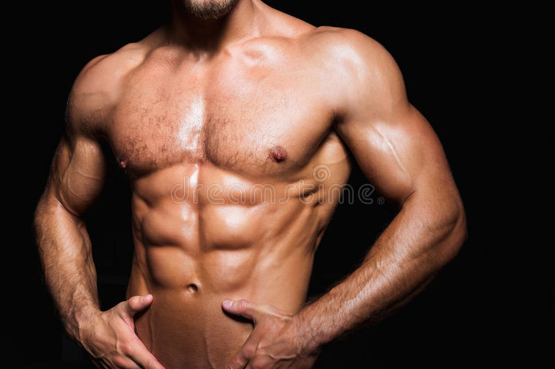 Muscular and torso of young sporty man with. Perfect abs close up stock photos