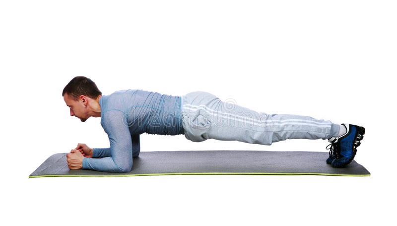 Download Muscular Sportsman Practicing Yoga On A Mat Stock Photo - Image: 40487674