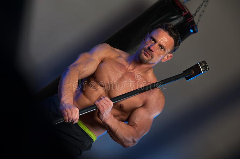 Muscular strong man training with hammer royalty free stock photos