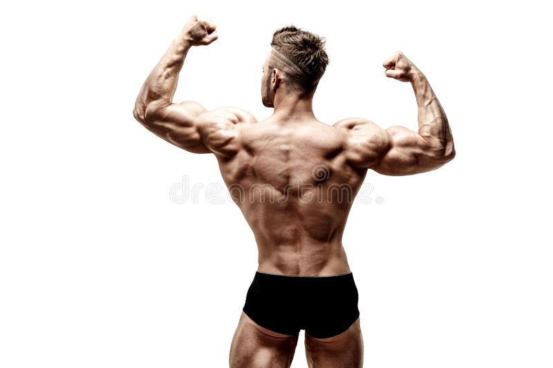 Muscular super-high level handsome man posing on white background royalty free stock photo