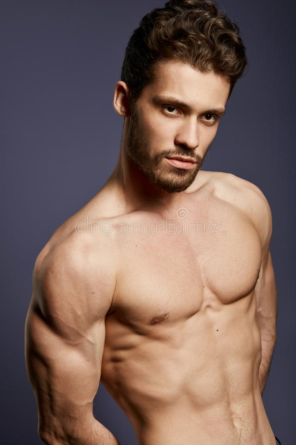 Muscular torso of young handsome man royalty free stock photo