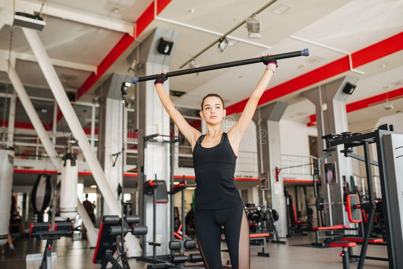 Beautiful sportive woman in gym stock photography
