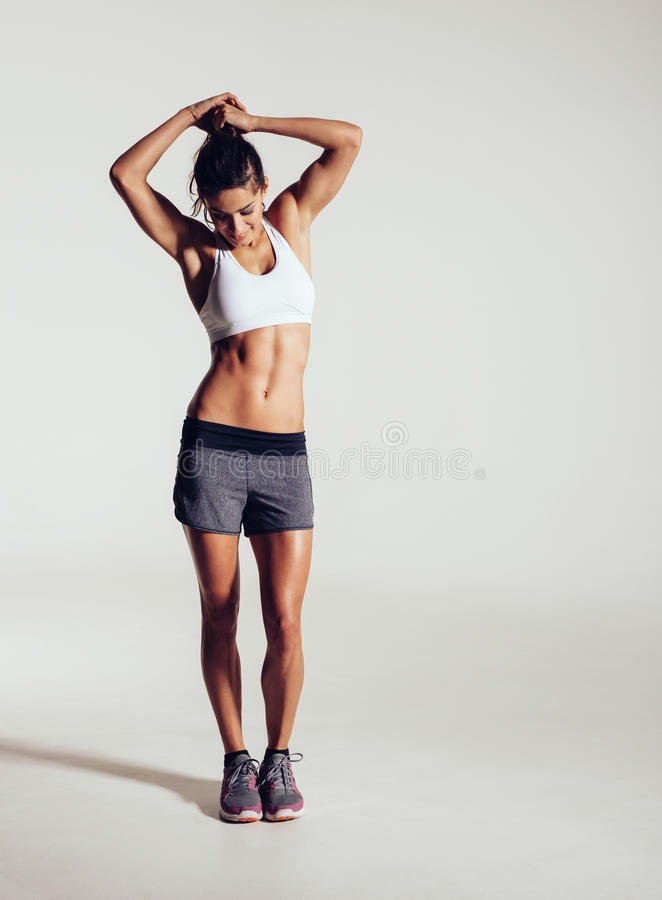 Muscular young fitness model in studio stock photos