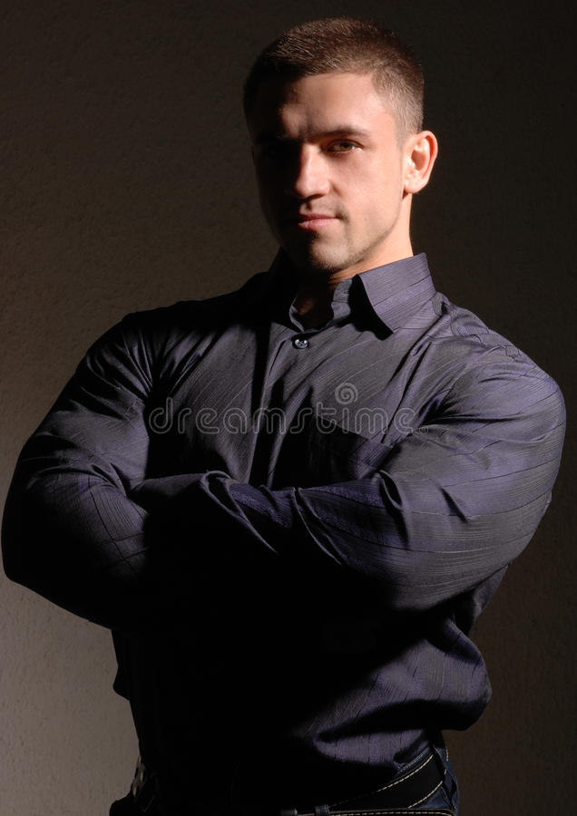 Muscular young male stock images