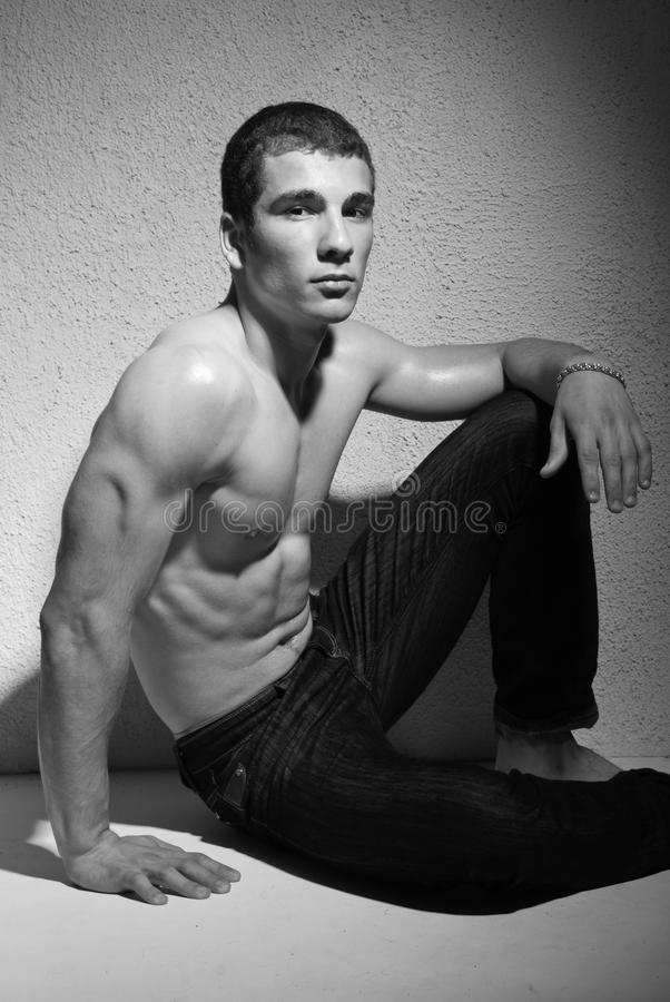 Muscular young man royalty free stock photography