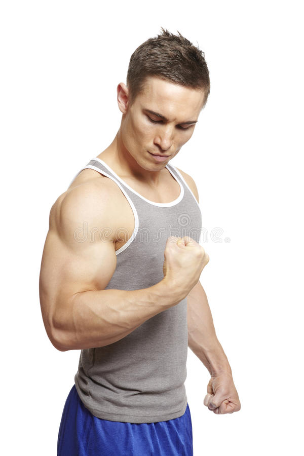 Download Muscular Young Man Flexing Arm Muscles In Sports Outfit Stock Image - Image of sport, confidence: 28511133