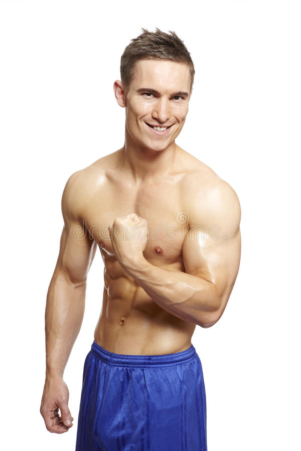 Muscular Young Man Flexing Arm Muscles In Sports Outfit Stock Photography