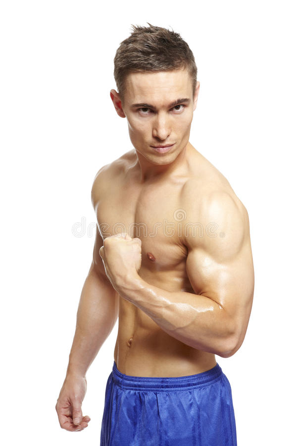Download Muscular Young Man Flexing Arm Muscles In Sports Outfit Stock Image - Image: 28921169