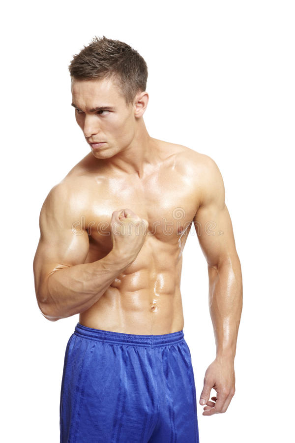 Muscular Young Man Flexing Arm Muscles In Sports Outfit Royalty Free Stock Image