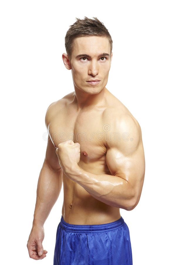 Download Muscular Young Man Flexing Arm Muscles In Sports Outfit Stock Photo - Image: 29343662