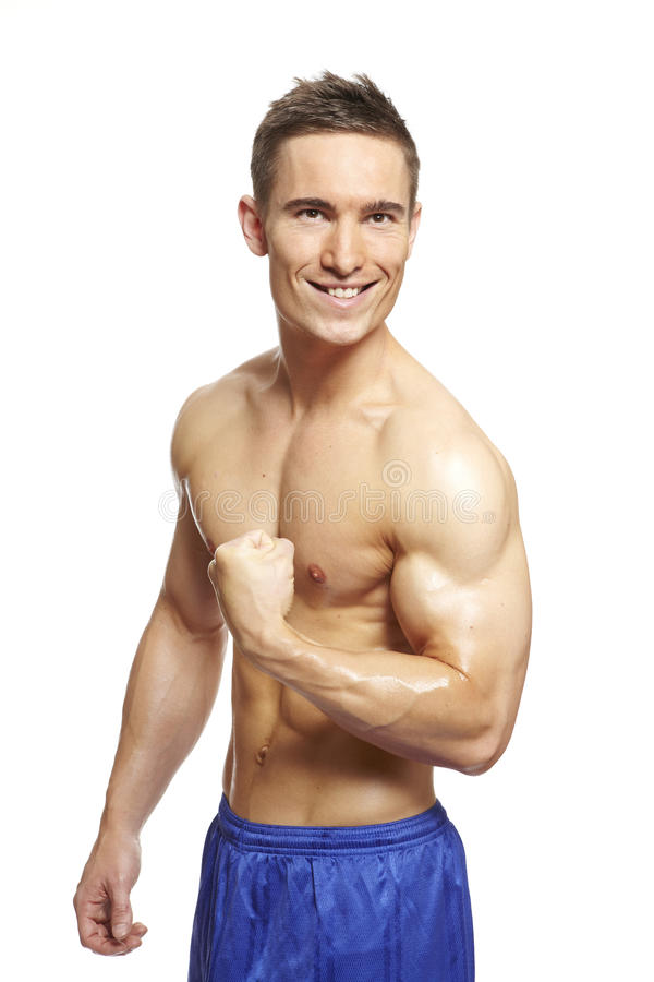 Download Muscular Young Man Flexing Arm In Sports Outfit Stock Photo - Image: 28159186