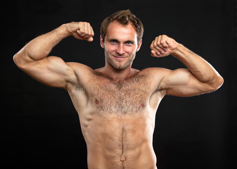 Muscular young man flexing his bice royalty free stock photo