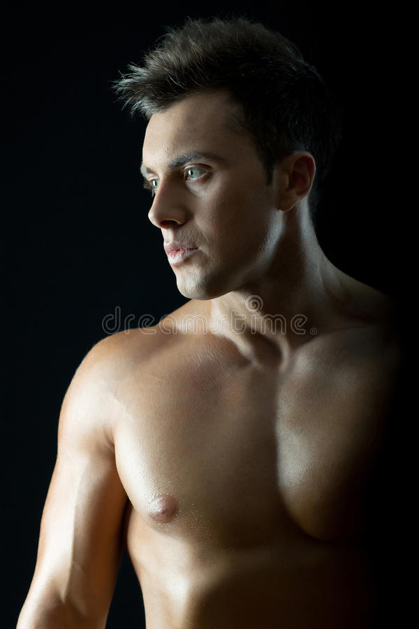 Muscular young man royalty free stock image