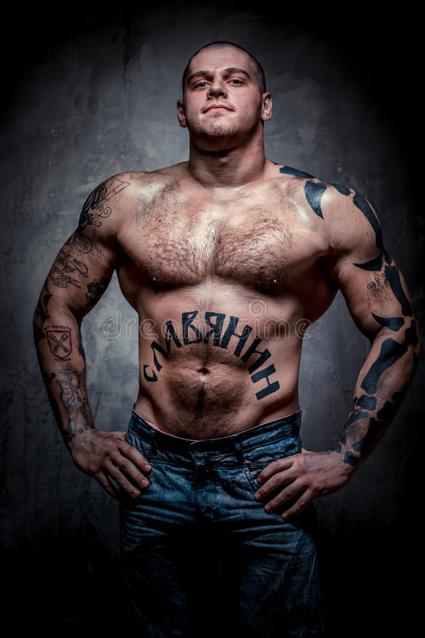 Muscular young man with many tattoos stock photo image for Chest tattoo prices