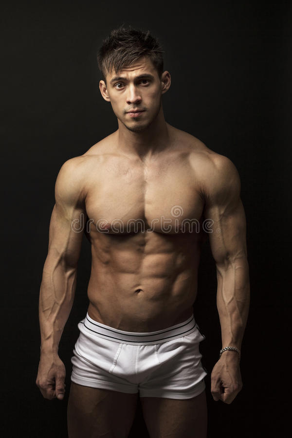 Muscular young man over black royalty free stock images