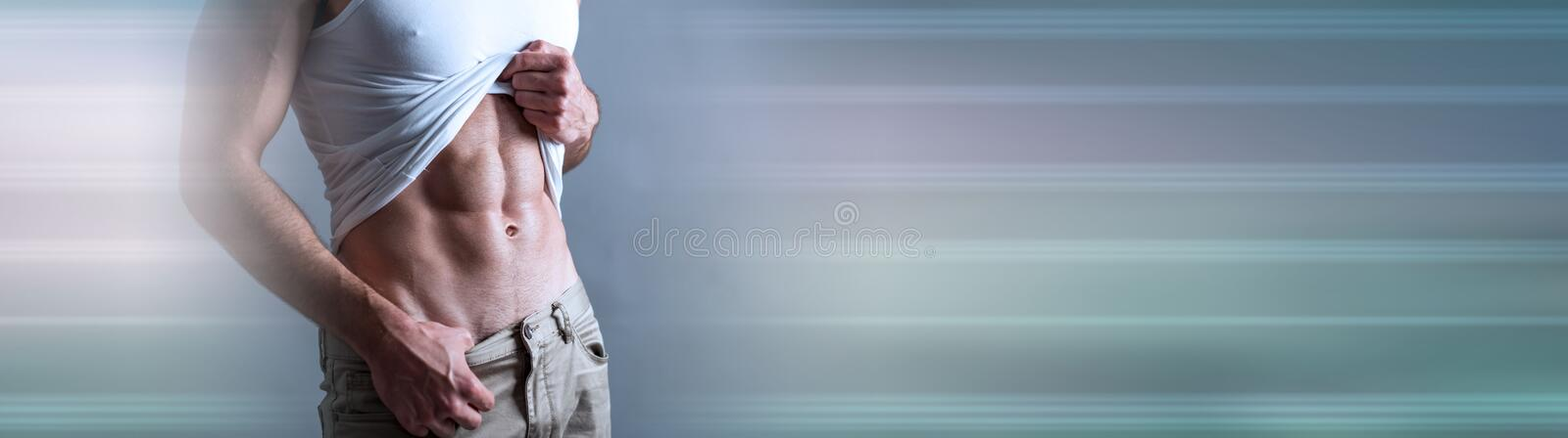 Abs of athletic man; panoramic banner stock photo