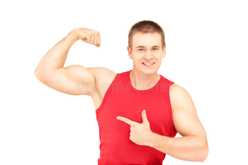 Muscular young man showing his biceps. Isolated on white background stock images