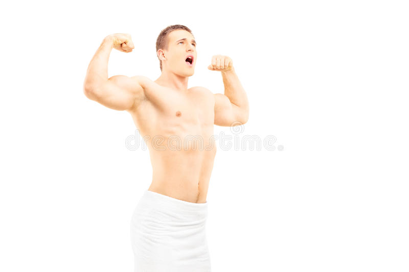 Muscular young man in towel posing stock images