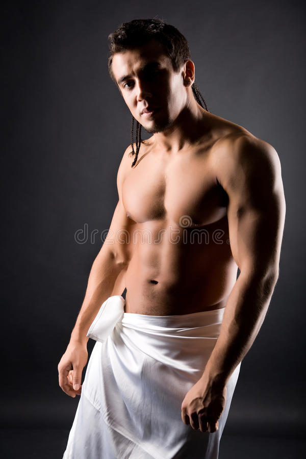 Muscular young naked man stock photo