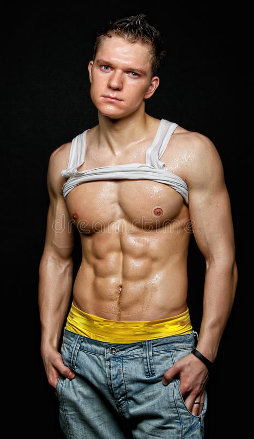 Muscular Young Wet Man In The White T-shirt Stock Photos