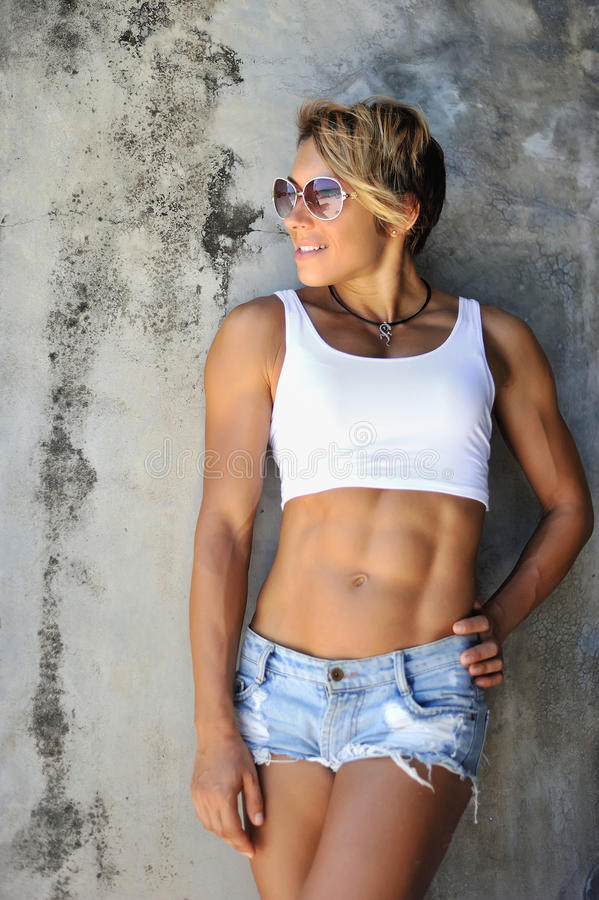 Muscular young woman athlete outdoor fashion portrait.  royalty free stock images