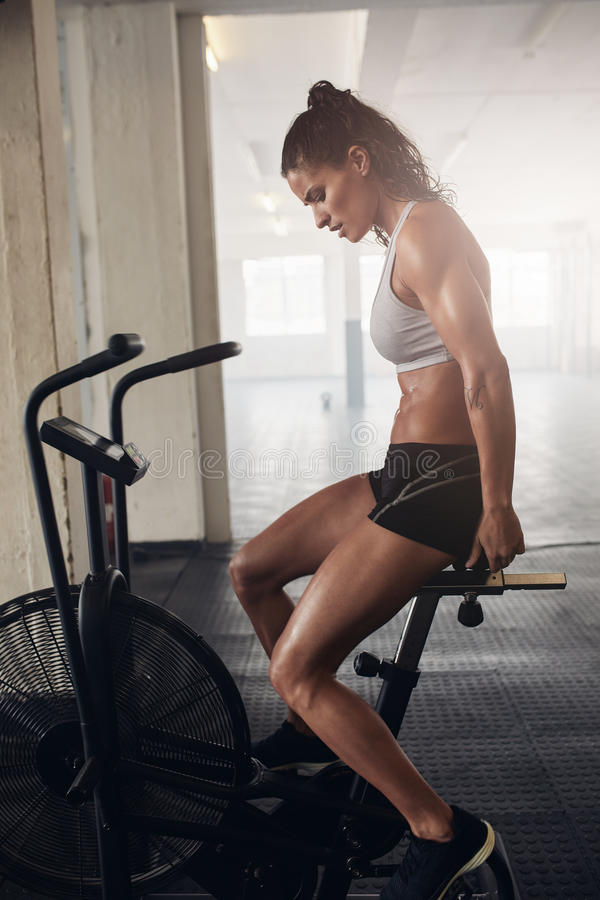 Muscular young woman doing intense cardio workout royalty free stock image